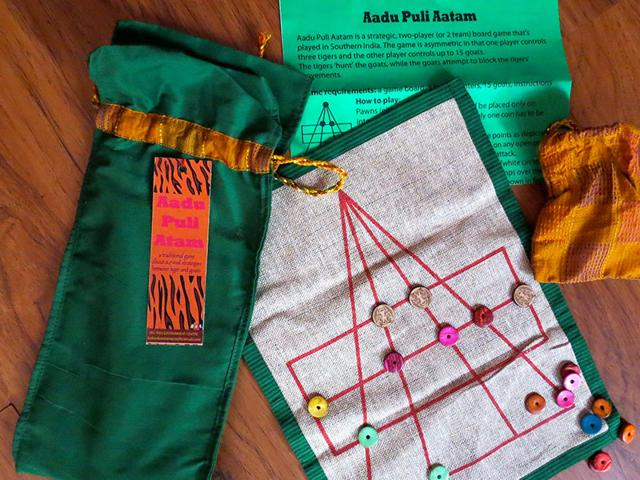 Aadu-Puli-Aatam-is-a-strategic-two-player-game-that-originated-in-southern-India