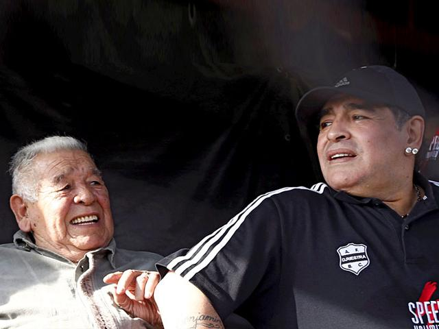 In-this-August-19-2013-file-photo-former-Argentina-captain-and-coach-Diego-Maradona-and-his-father-Diego-Maradona-Senior-L-Don-Diego-attend-the-Primera-D-match-between-Deportivo-Riestra-and-San-Miguel-in-Buenos-Aires-Don-Diego-died-on-June-25-2015-aged-87-due-to-heart-and-respiratory-problems-Reuters-Photo
