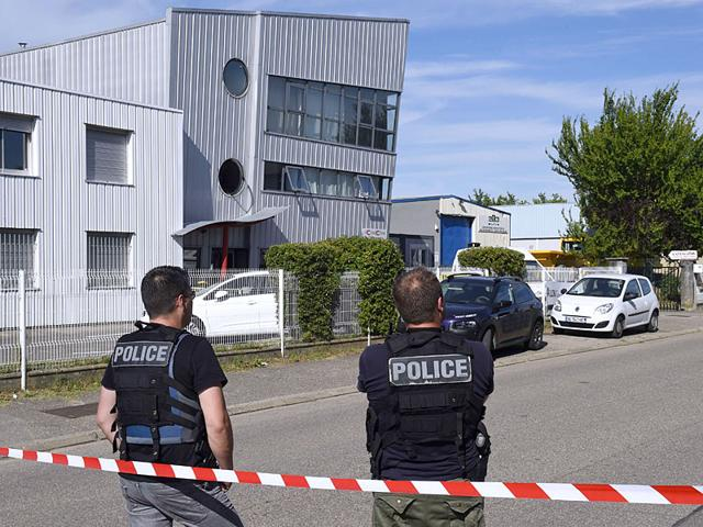 French-police-officers-stand-guard-near-a-cordon-outside-the-Colicom-delivery-service-company-in-Chassieu-near-Lyon-where-the-victim-who-was-decapitated-during-the-attack-earlier-in-the-day-in-Saint-Quentin-Fallavier-worked-AFP-Photo