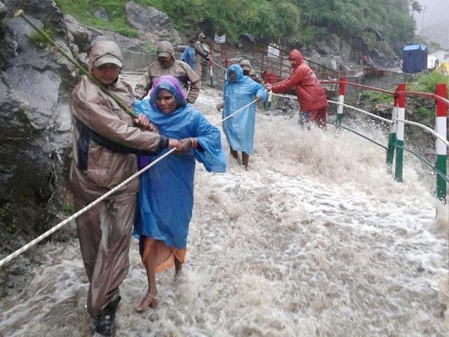 Rudraprayag-Rescue-teams-help-out-pilgrims-amid-a-heavy-water-flow-due-to-heavy-rainfall-in-Rudraprayag-on-Saturday-PTI-Photo