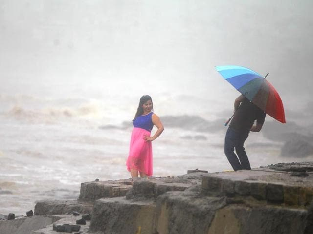 A-woman-poses-for-a-picture-in-the-rain-at-Carter-Road-in-Mumbai-Satish-Bate-HT-photo