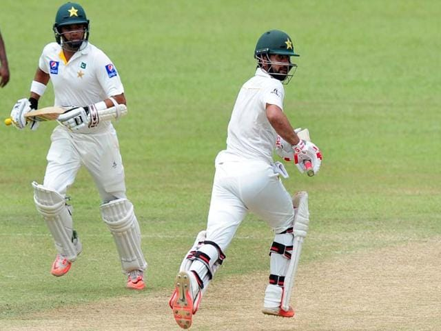 Pakistan-cricketers-Ahmed-Shehzad-R-and-Azhar-Ali-run-between-wickets-during-the-third-day-of-the-second-Test-match-between-Sri-Lanka-and-Pakistan-at-the-P-Sara-Oval-Cricket-Stadium-in-Colombo-on-June-27-2015-AFP-Photo