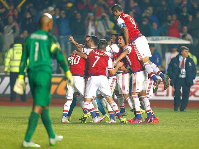 Paraguay-s-players-celebrate-as-Brazil-goalkeeper-Jefferson-de-Oliveira-Galvao-looks-on-after-Derlis-Gonzalez-scored-the-winning-penalty-kick-against-Brazil-during-the-Copa-America-quarter-final-at-the-Ester-Roa-Rebolledo-Stadium-in-Concepcion-Chile-on-June-27-2015-Paraguay-beat-Brazil-4-3-on-penalties-after-the-match-ended-1-1-AP-Photo