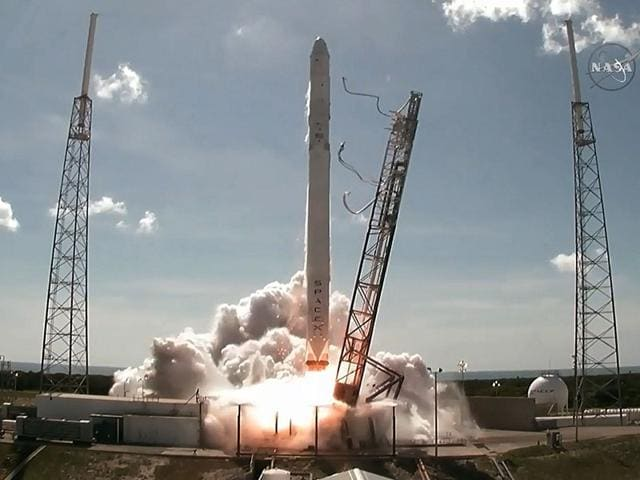 A-photo-grab-from-NASA-TV-shows-the-SpaceX-Falcon-9-rocket-with-the-unmanned-Dragon-cargo-capsule-on-board-Launches-from-Cape-Canaveral-Florida-AFP-Photo