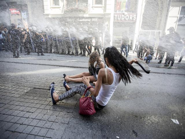 Riot-police-use-a-water-cannon-to-disperse-LGBT-rights-activist-before-a-Gay-Pride-Parade-in-central-Istanbul-Turkey-on-Sunday-The-police-appeared-intent-on-stopping-the-crowd-gathering-near-Taksim-Square-Taksim-is-a-traditional-rallying-ground-for-demonstrators-and-saw-weeks-of-unrest-in-2013-REUTERS-Kemal-Aslan