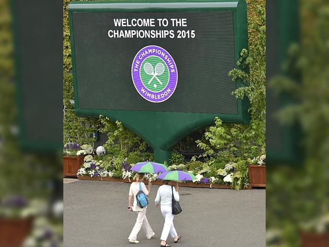 Visitors-shelter-from-the-rain-at-Wimbledon-in-London-on-June-28-2015-The-Championships-begin-on-Monday-June-29-Reuters-Photo
