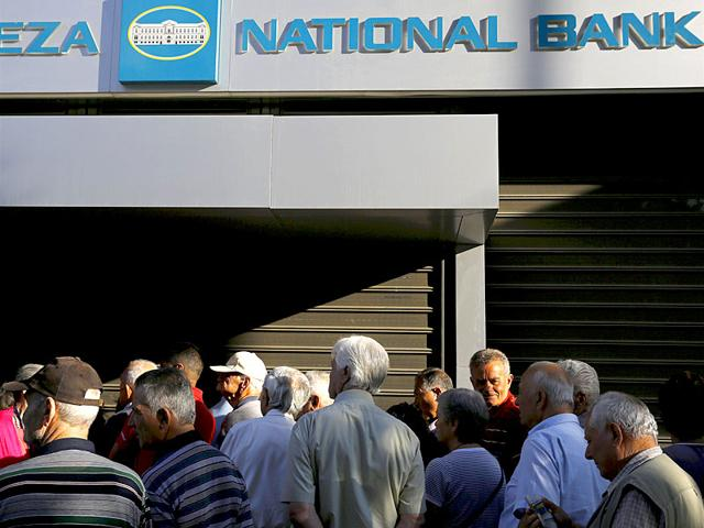 Dozens-of-pensioners-line-up-outside-a-branch-of-the-National-Bank-of-Greece-hoping-to-get-their-pensions-in-Athens-Greece-closed-its-banks-and-imposed-capital-controls-on-Sunday-to-check-the-growing-strains-on-its-crippled-financial-system-bringing-the-prospect-of-being-forced-out-of-the-euro-into-plain-sight--Reuters