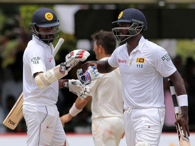 Sri-Lankan-captain-Angelo-Mathews-right-congratulates-Lahiru-Thirimanne-after-defeating-Pakistan-by-7-wickets-in-their-second-cricket-Test-match-in-Colombo-Sri-Lanka-on-June-29-2015-The-three-match-series-is-tied-1-1-AP-Photo