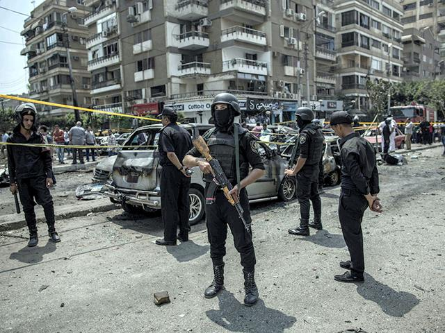 Egyptian-policemen-stand-guard-at-the-site-of-a-bombing-that-killed-Egypt-s-top-prosecutor-Hisham-Barakat-in-Cairo-AP-Photo