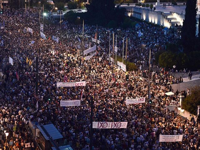 Carrying-banners-calling-for-a-NO-vote-in-the-forthcoming-referendum-on-bailout-conditions-set-by-the-country-s-creditors-around-17-000-protesters-gather-in-front-of-the-Greek-parliament-in-Athens-AFP-Photo-Louisa-Gouliamaki