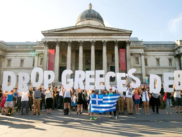 Demonstrators-take-part-in-a-protest-against-the-European-Central-Bank-in-Trafalgar-Square-London-over-Greece-s-debt-repayments-AP-Photo