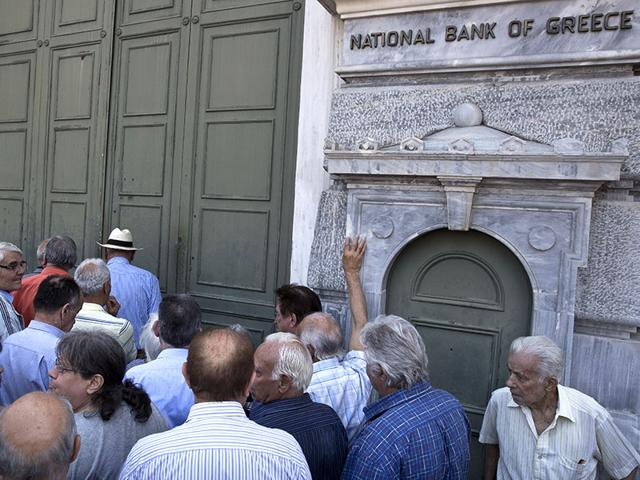 An-elderly-man-is-crying-outside-a-national-bank-branch-as-pensioners-queue-to-get-their-pensions-with-a-limit-of-120-euros-in-Thessaloniki-on-3-July-2015-AFP-Photo