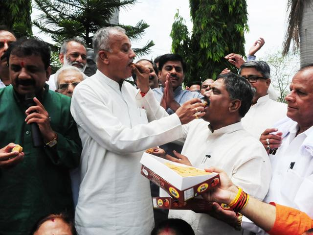 BJP-state-president-Nand-Kumar-Singh-Chauhan-shares-sweets-with-party--men-to-celebrate-party-s-win-in-Garoth-by-poll-in-Bhopal-on-Tuesday-Mujeeb-Faruqui-HT