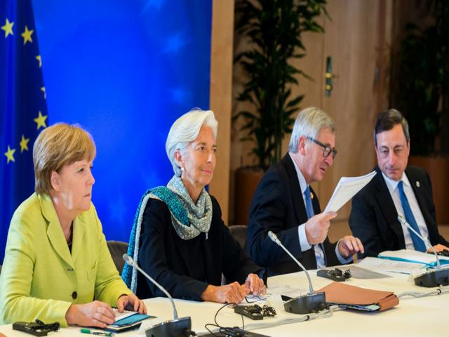 In-this-file-photo-dated-Monday-June-22-2015-from-left-German-Chancellor-Angela-Merkel-managing-director-of-the-International-Monetary-Fund-Christine-Lagarde-European-Commission-president-Jean-Claude-Juncker-and-European-Central-Bank-Governor-Mario-Draghi-participate-in-a-meeting-in-Brussels-AP-Photo-Geert-Vanden-Wijngaert