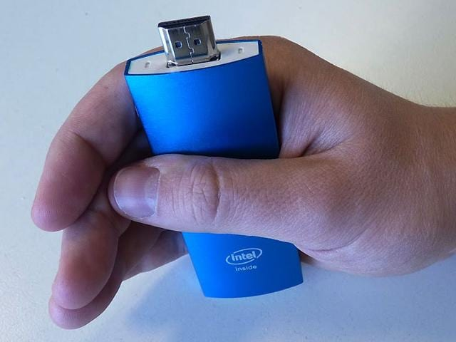 The-Archos-PC-Stick-looks-like-an-HDMI-dongle-and-will-transform-any-compatible-screen-into-a-computer-Photo-AFP