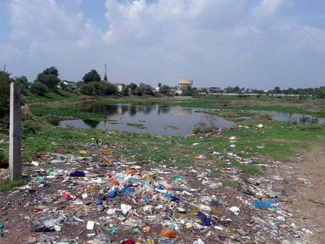 The-Bijalpur-lake-in-Indore-lacks-fencing-making-it-an-easy-dumping-ground-for-local-and-a-hub-for-anti-social-activities-HT-photo