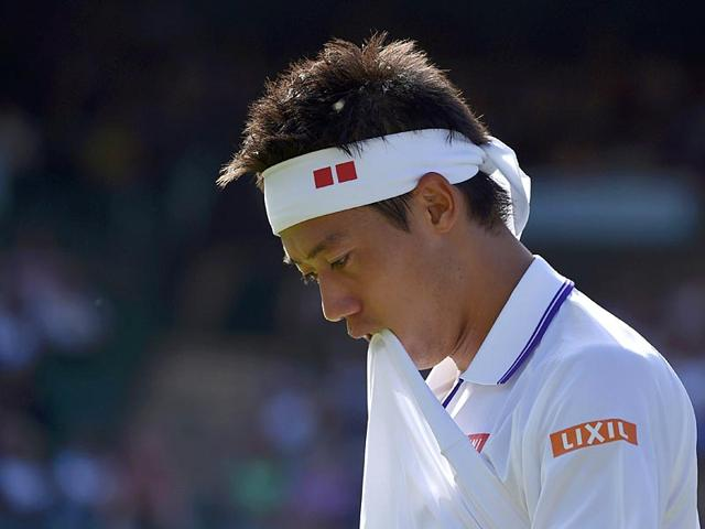 Kei-Nishikori-of-Japan-reacts-during-his-first-round-men-s-singles-match-against-Simone-Bolelli-of-Italy-at-the-Wimbledon-Tennis-Championships-in-London-on-June-29-2015-The-5th-seeded-Japanese-withdrew-from-the-tournament-on-July-1-2015-after-aggravating-a-calf-injury-sustained-at-the-Gerry-Weber-Open-in-Halle-Germany-two-weeks-earlier-Reuters-Photo