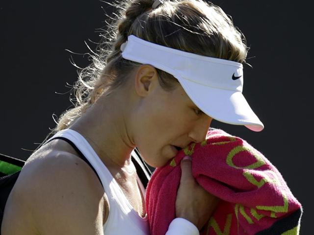 Eugenie-Bouchard-of-Canada-leaves-the-court-after-losing-to-Ying-Ying-Duan-of-China-in-the-women-s-singles-first-round-match-at-the-All-England-Lawn-Tennis-Championships-in-Wimbledon-London-on-June-30-2015-AP-Photo