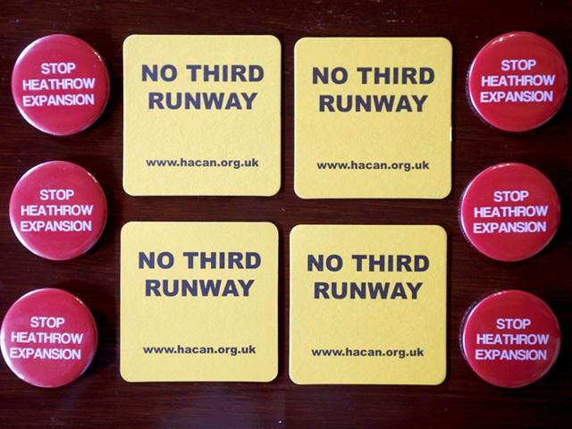 Badges-and-beer-mats-protesting-at-the-proposed-expansion-of-Heathrow-airport-are-seen-inside-a-pub-in-the-village-of-Harmondsworth-adjacent-to-the-airport-in-London-Photo-Reuters
