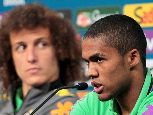 Brazil-s-Douglas-Costa-R-speaks-next-to-teammate-David-Luiz-during-a-news-conference-in-Porto-Alegre-Brazil-on-June-11-2015-Costa-has-signed-a-five-year-deal-to-move-to-Bayern-Munich-from-current-club-Shakhtar-Donetsk-Reuters-Photo