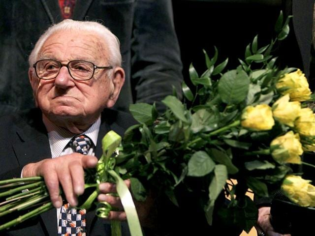 Nicholas-Winton-aged-101-holds-flowers-while-sitting-on-a-stage-after-the-premiere-of-the-movie-Nicky-s-family-which-is-based-on-his-life-story-in-Prague-Reuters-Photo