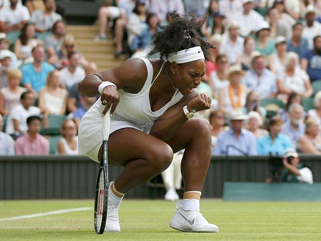 US-player-Serena-Williams-reacts-during-the-first-set-of-her-second-round-women-s-singles-match-against-Hungary-s-Timea-Babos-on-Day-3-of-the-2015-Wimbledon-Championships-at-The-All-England-Tennis-Club-in-Wimbledon-London-on-July-1-2015-Williams-won-6-4-6-1-AFP-Photo