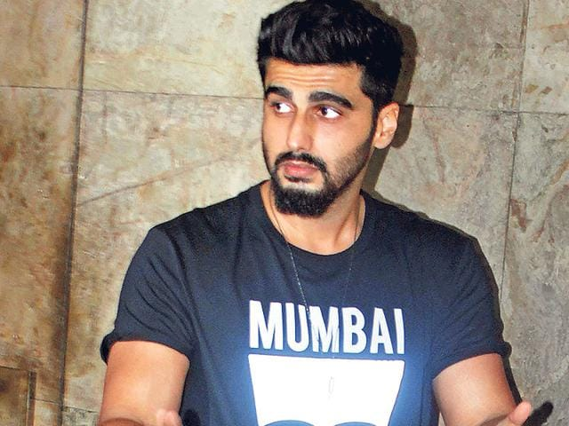 Arjun Kapoor outisde R Balki's office on Friday night. And though it was dark, he actors sported sun glares. (Photo: Yogen Shah)