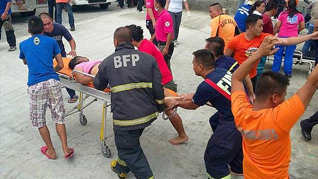 A-survivor-of-the-passenger-ferry-is-being-pushed-on-a-stretcher-to-a-waiting-ambulance-after-arriving-at-the-pier-in-Ormoc-City-central-Philippines-AFP-Photo