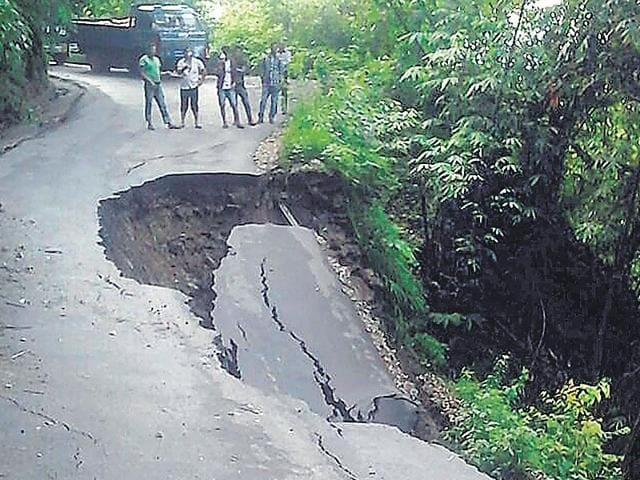 People-look-at-a-damaged-road-in-the-landslide-hit-area-of-Mirik-near-Siliguri-on-Thursday-PTI-Photo