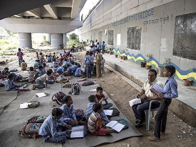 A Delhi school under a Metro bridge