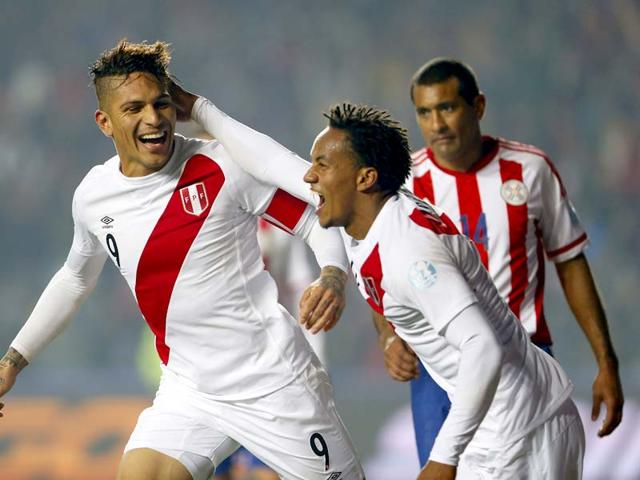 Peru-s-Jose-Paolo-Guerrero-L-celebrates-with-teammate-Andre-Carrillo-after-scoring-his-team-s-second-goal-against-Paraguay-during-the-2015-Copa-America-third-place-play-off-match-at-the-Ester-Roa-Rebolledo-Stadium-in-Concepcion-Chile-on-July-3-2015-AP-Photo