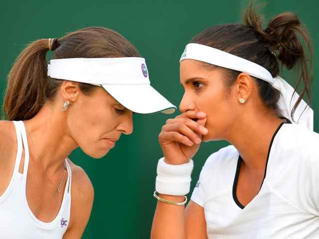 Switzerland-s-Martina-Hingis-L-and-India-s-Sania-Mirza-react-during-their-women-s-doubles-second-round-match-of-the-2015-Wimbledon-Championships-against-Italy-s-Francesca-Schiavone-and-Japan-s-Kimiko-Date-Krumm-at-The-All-England-Lawn-Tennis-and-Croquet-Club-in-London-on-July-3-2015-AFP-Photo