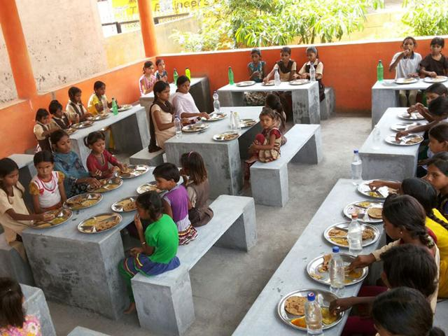 Children-have-their-mid-day-meals-in-the-newly-constructed-dining-hall-at-a-school-in-Indore-district-HT-photo