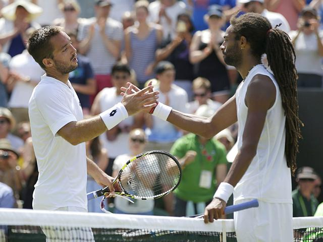 Viktor-Troicki-of-Serbia-left-shakes-hands-with-Dustin-Brown-of-Germany-after-defeating-him-in-their-men-s-singles-third-round-match-of-Wimbledon-at-The-All-England-Lawn-Tennis-and-Croquet-Club-in-London-on-July-4-2015-Troicki-won-6-4-7-6-4-6-6-3-AP-Photo