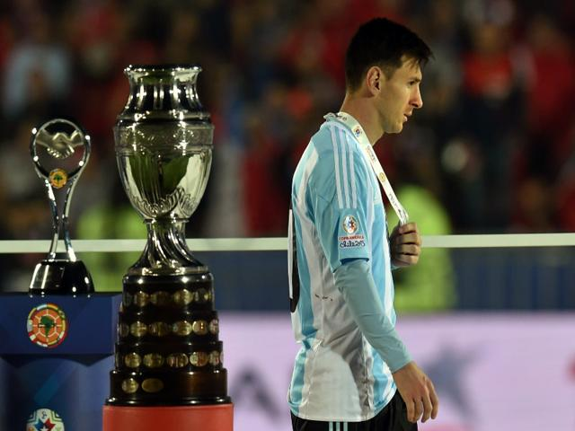 Argentina-s-forward-Lionel-Messi-walks-with-the-second-place-medal-of-the-2015-Copa-America-football-championship-in-Santiago-Chile-on-July-4-Chile-defeated-Argentina-4-1-in-the-penalty-shootout-AFP-Photo