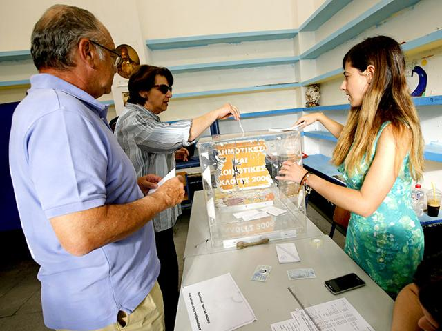 People-prepare-to-cast-ballots-during-a-referendum-in-Athens--Reuters