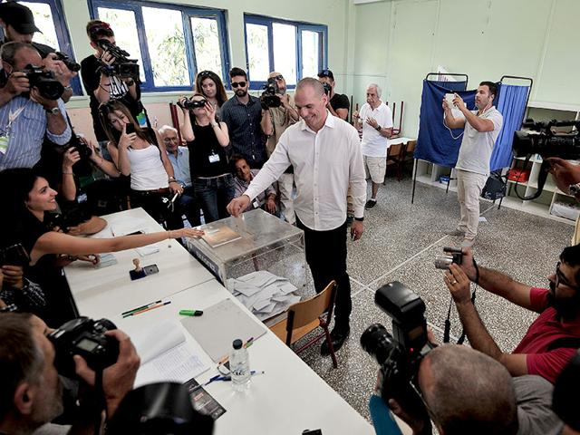 Greece-s-Finance-Minister-Yanis-Varoufakis-cast-his-vote-at-a-polling-station-in-Athens-Sunday-July-5-2015-AP-Photo