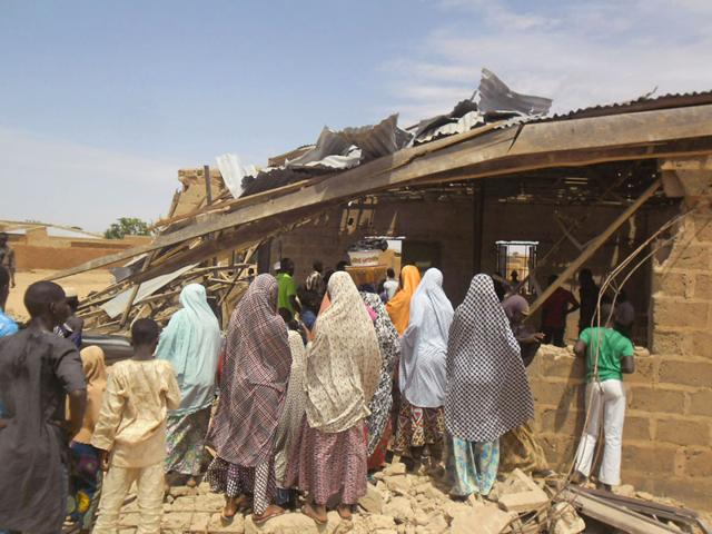 People-gather-around-the-Redeemed-Christian-Church-of-God-after-the-bomb-blast-in-Potiskum-Nigeria-AP-Photo