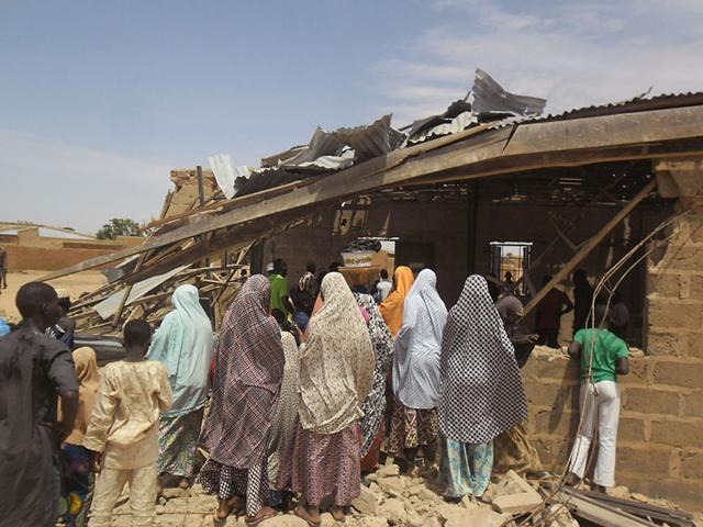People-gather-around-the-Redeemed-Christian-Church-of-God-after-a-bomb-blast-in-Potiskum-Nigeria-AP-Photo