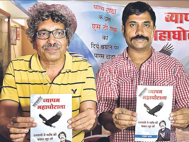 Former-MLA-Paras-Sakhlecha-left-with-RTI-activist-Ajay-Dubey-release-Vyapamgate-a-book-on-the-PEB-scam-in-Bhopal-on-Sunday-HT-Photo-Mujeeb-Faruqui