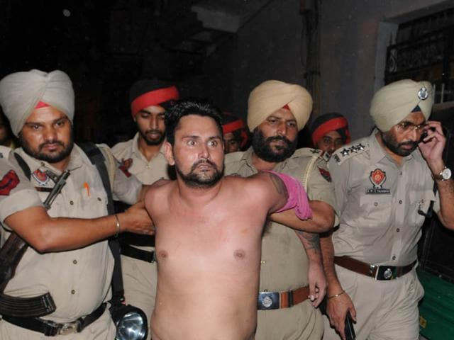 Police-officials-arrest-one-of-the-gangsters-accused-of-the-murderous-attack-on-DSP-prison-Vikramjit-Panthe-in-Jalandhar-on-Sunday-Pardeep-Pandit-HT-Photo