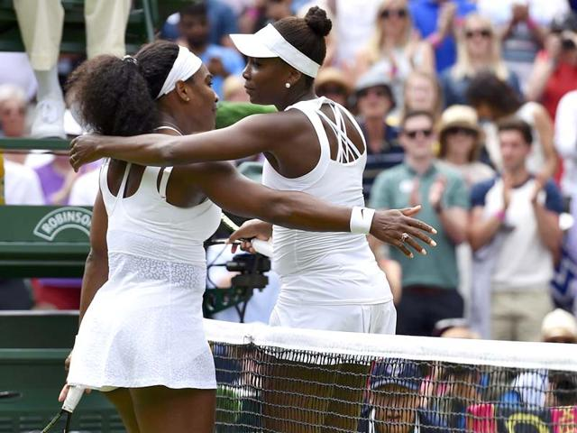 Serena-Williams-left-of-the-USA-embraces-sister-Venus-Williams-after-winning-their-women-s-singles-fourth-round-match-of-the-2015-Wimbledon-Championships-at-The-All-England-Lawn-Tennis-and-Croquet-Club-in-London-on-July-6-2015-Serena-won-6-4-6-3-Reuters-Photo