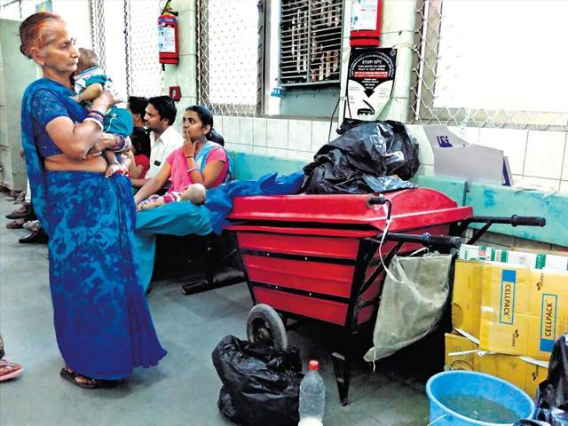 Patients-wait-near-a-pile-of-hazardous-bio-medical-waste-at-the-Kalawati-Saran-Hospital-Saumya-Khandelwal-HT-Photo