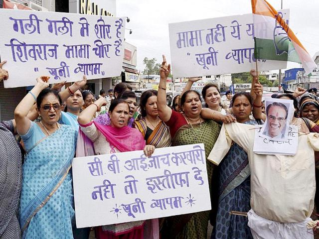 Congress-activists-burn-an-effigy-of-Madhya-Pradesh-chief-minister-Shivraj-Singh-Chouhan-demanding-his-resignation-and-a-CBI-probe-into-the-death-of-people-linked-with-Vyapam-scam-in-Bhopal-PTI-Photo