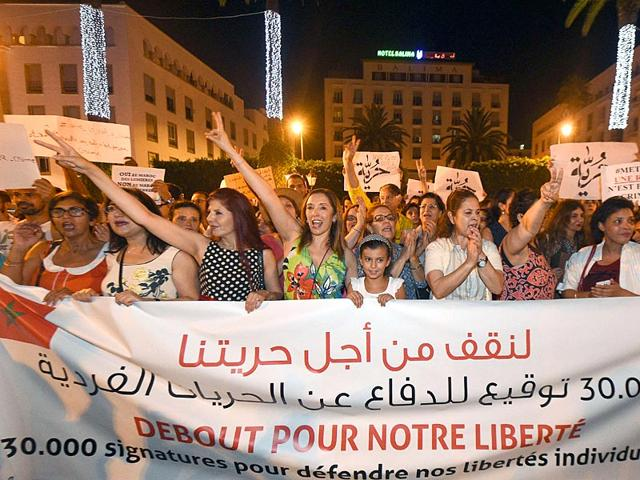 Moroccans-shout-slogans-and-hold-placards-during-a-demonstration-in-Rabat-on-July-6-2015-The-protesters-demonstrated-for-freedom-and-against-the-arrest-of-two-Moroccan-women-after-their-outfits-were-deemed-inappropriate-AFP-Photo