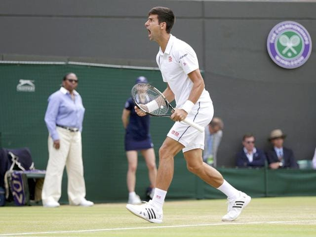 Novak-Djokovic-of-Serbia-reacts-to-breaking-Kevin-Anderson-s-serve-in-the-fifth-set-during-his-men-s-singles-fourth-round-match-of-the-2015-Wimbledon-Championships-at-The-All-England-Lawn-Tennis-and-Croquet-Club-in-London-on-July-7-2015-Djokovic-won-6-7-6-6-7-6-6-1-6-4-7-5-Reuters-Photo