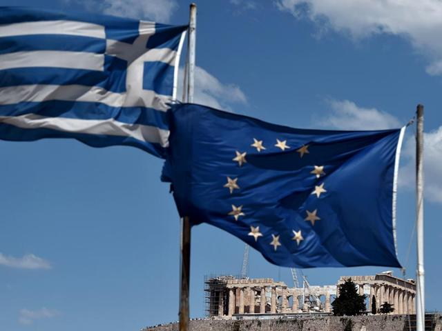 EU-and-Greek-flag-wave-in-front-of-the-ancient-temple-of-Parthenon-in-Athens-AFP-Photo