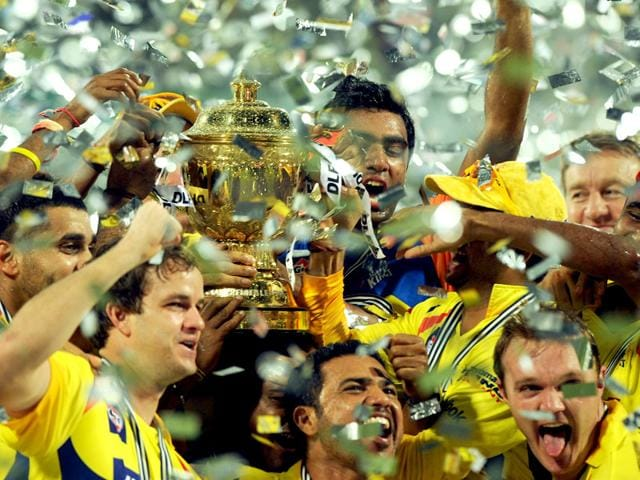 Chennai Super Kings players celebrate with the trophy after winning the 2011 IPL final against Royal Challengers Bangalore. Chennai Super Kings and Rajasthan Royals were suspended for two years by a Supreme Court-appointed panel on July 14, 2015 due to their owners indulging in illegal betting. (AFP Photo)