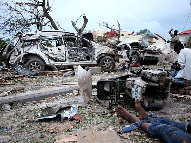 A-body-lies-in-the-rubble-next-to-damaged-cars-near-the-Jazeera-Palace-hotel-following-a-suicide-attack-in-Mogadishu--AFP-Photo
