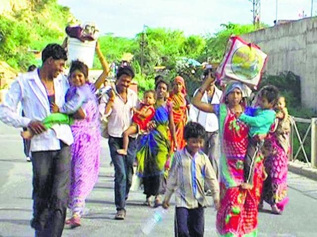 Families-leave-for-safer-places-after-heavy-rainfall-that-caused-a-flood-like-situation-in-Dholpur-and-Karauli-on-Sunday-HT-Photo